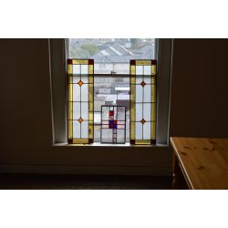 Set of four stained glass panels.